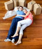 Couple lying on floor — Stock Photo