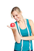 Woman with red apple and measure tape — Stock Photo