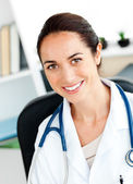 Self-assured female doctor smiling at the camera — Stock Photo