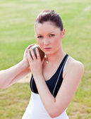 Determined female athlete ready to throw weight — Stock Photo