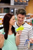 Delighted couple buying products — Stok fotoğraf