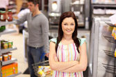Portrait of a smiling food retailer with a male customer in her — Stock Photo