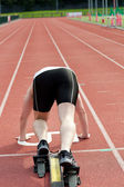 Sporty man waiting in starting block — Stock Photo