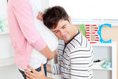Close-up of a lovely man with head on his pregnant woman's belly — Stock Photo