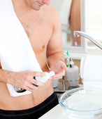 Close-up of a good-looking man preparing to shave in the bathroo — Stock Photo