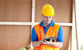 Self-assured male worker writing on a clipboard — Stock Photo