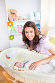 Attentive young mother taking care of her adorable baby — Stock Photo