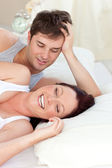 Glowing caucasian couple lying on bed — Stock Photo