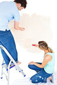 Concentrated couple painting a room — Stock Photo