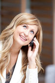 Positive businesswoman talking on phone — Stock Photo