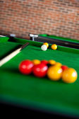 Close-up of a billiard with balls and cue — 图库照片