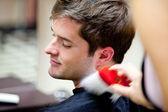 Cute caucasian customer in a hairdressing salon — Stock Photo