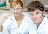 Two caucasian scientists doing experiments — Stock Photo
