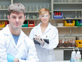 Two assertive scientists looking at the camera standing — Stock Photo