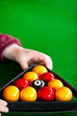 Close-up of a snooker player placing balls with triangle — Photo