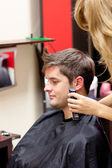 Young caucasian man being shaved — Stock Photo