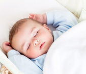 Portrait of a peaceful baby sleeping in his cradle at home — Stock Photo