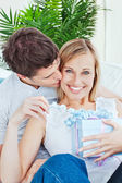 Portrait of a happy woman receiving a present from her boyfriend — Stock Photo