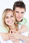 Portrait of a lovely couple smiling at the camera standing again — Stock Photo