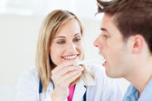 Portrait of a female doctor taking a saliva sample of a male pat — Stock Photo
