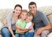 Happy family sitting on the sofa — Stock Photo