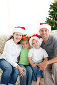 Adorable family at Christmas sitting in the living-room — Stock Photo