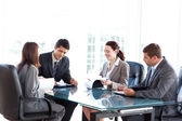 Four business during a meeting — Stockfoto