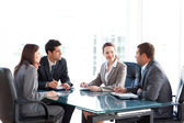 Businessmen and businesswomen talking during a meeting — Stock Photo