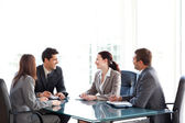 Happy businessteam talking together during a meeting — Stock Photo