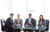 Businessteam looking at the camera during a presentation — Stock Photo