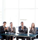 Cheerful businessteam applauding during a presentation — Stock Photo