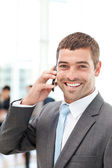 Happy hispanic businessman on the phone while his team is workin — Stock Photo
