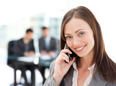 Captivating businesswoman on the phone while her team is working — Stock Photo