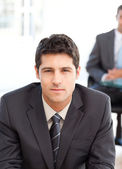 Serious businessman during an interview with a co-worker — Stock Photo