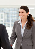 Businesswoman shaking hands with a businssman — Stock Photo