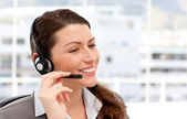 Pretty businesswoman with earpiece — Stock Photo