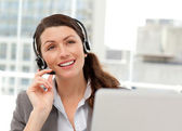 Thoughtful businesswoman talking on the phone while working on h — Stock Photo
