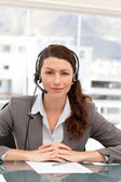 Portrait of a charismatic businesswoman with earpiece — Stock Photo