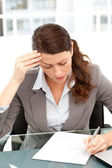 Worried businesswoman working at a table — Stock Photo