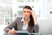 Serious female executive finding ideas while working at her desk — Stock Photo