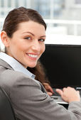 Rear view of a happy businesswoman working on her laptop — Stock Photo