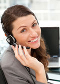 Pretty female representative on the phone with earpiece on — Stock Photo