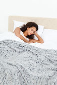 Beautiful woman sleeping peacefully on her bed in the morning — Stock Photo
