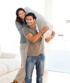 Man and woman carrying a carpet together — Stock Photo