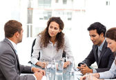 Beautiful manager speaking with her team during a meeting — Stock Photo