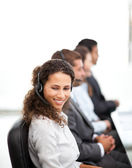 Happy representative with her colleagues working in a call cente — Stock Photo
