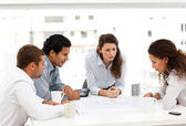 Four charismatic architects looking at plans together — Stock Photo