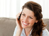 Pretty businesswoman talking on the phone at home — Stock Photo