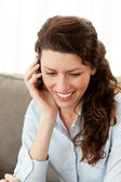 Smiling businesswoman on the phone while resting on the sofa — Stock Photo