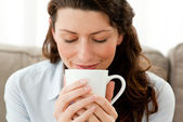 Cute businesswoman enjoying her coffee at home — Stock Photo
